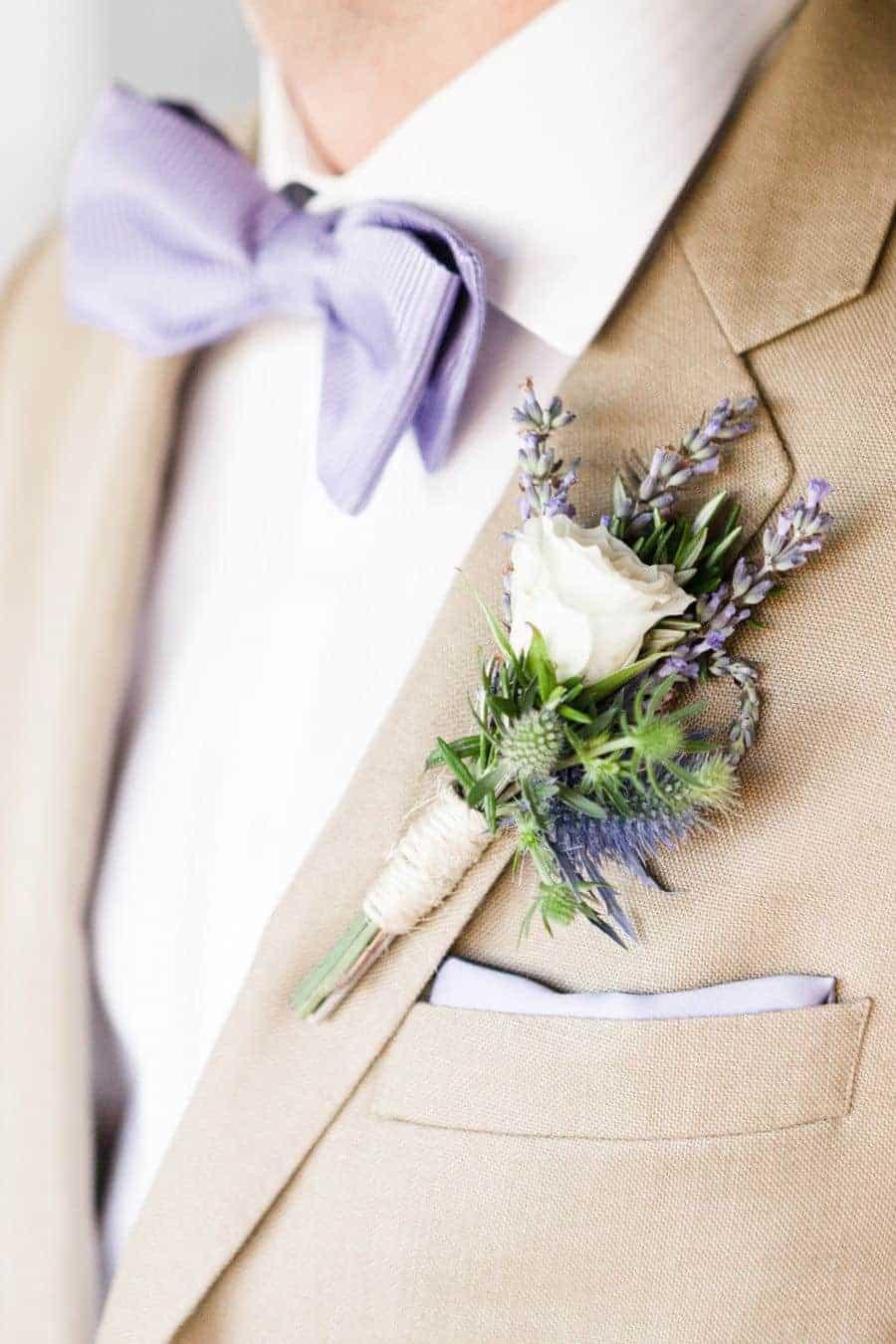 groom with purple bow
