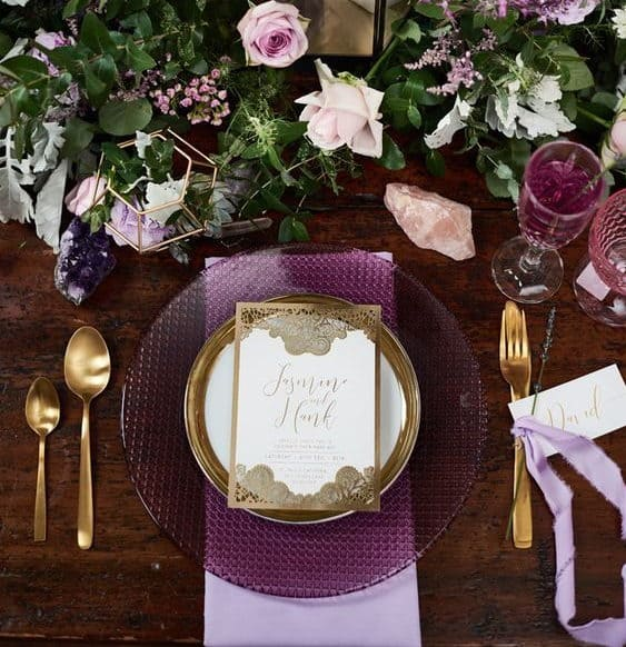 wedding table decoration in with purple plate