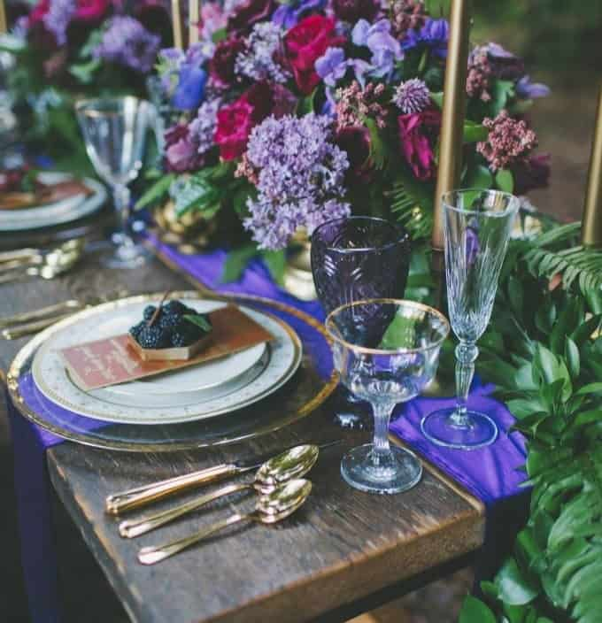 wedding table decoration in with purple runner