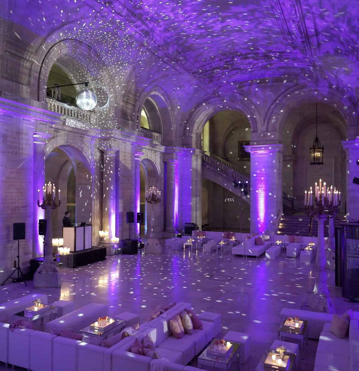 wedding dinner decoration with purple lighting