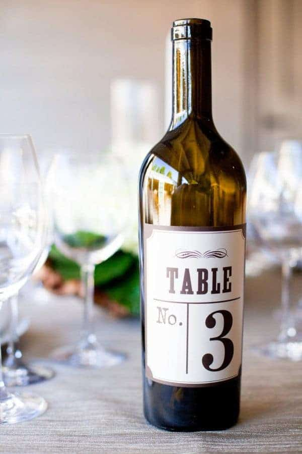 wedding dinner table numbering with a wine bottle