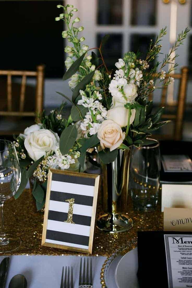 wedding dinner table numbering with a bronze frame with black and white stripes