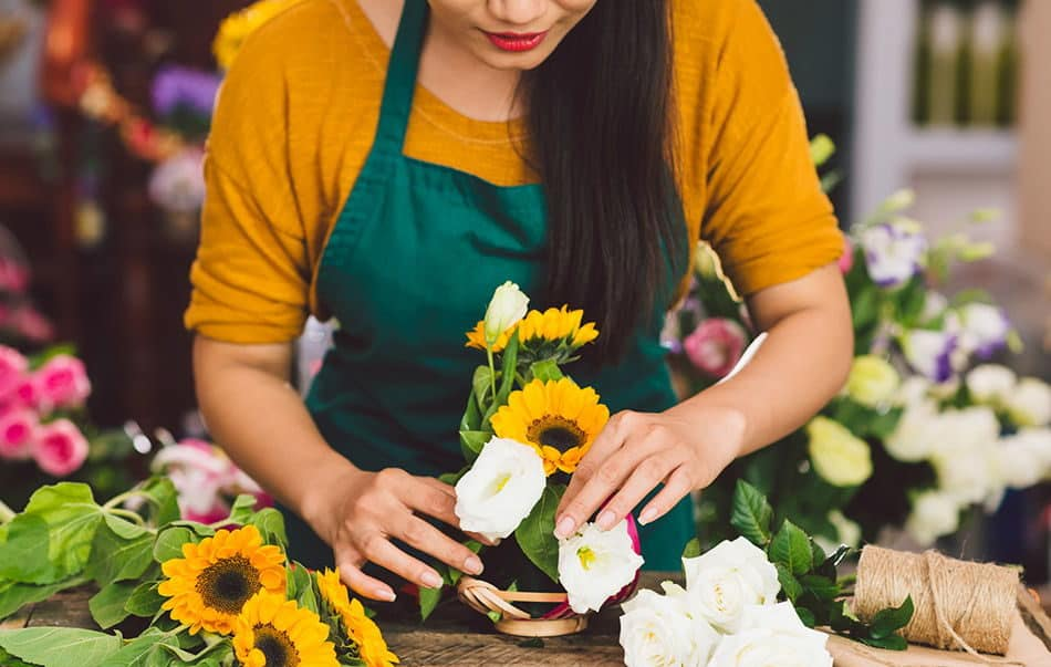 creating a flower bouquet with sunflowers