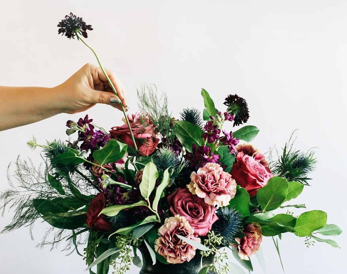 wedding flower bouquet in a black vase