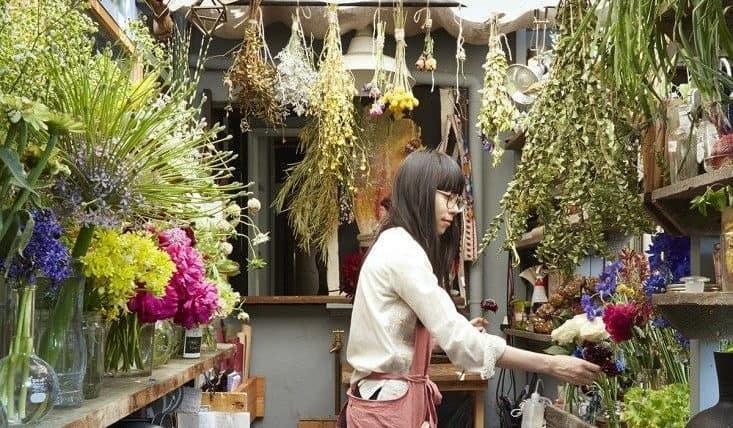 florist get organised in her flower shop