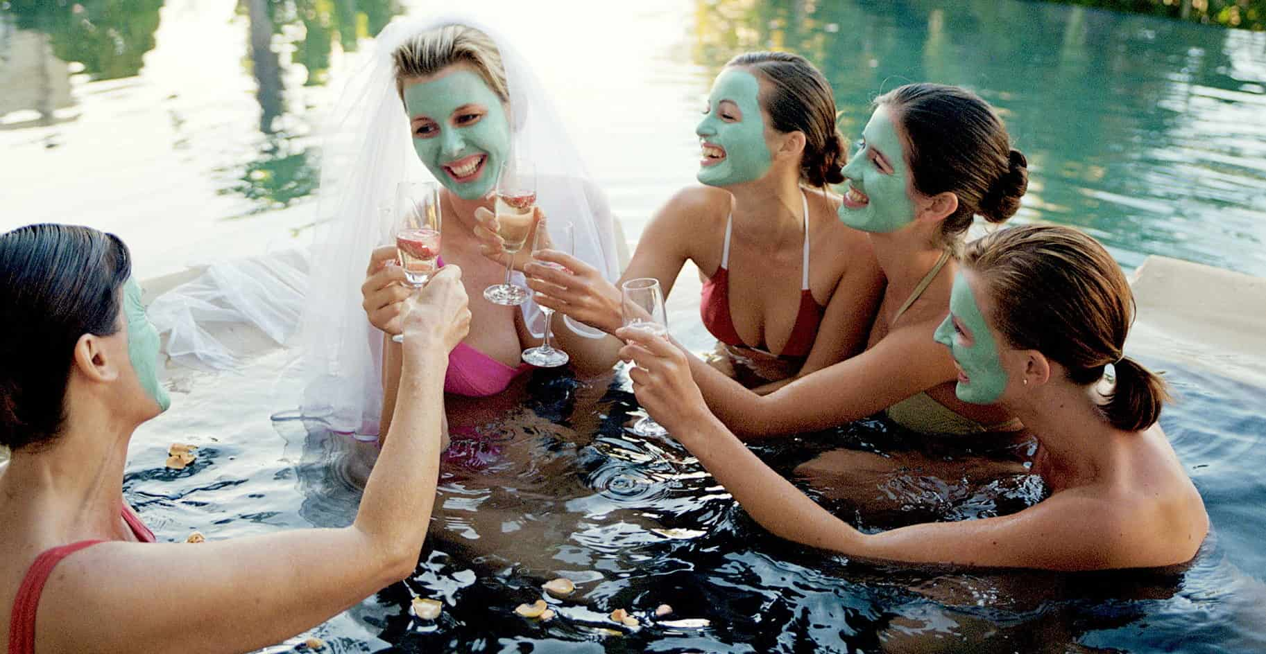summer bachelorette party in the pool covered their faces with facial beauty masks