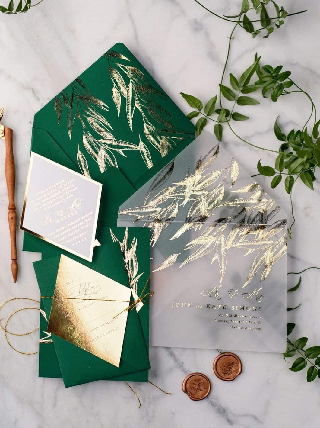 wedding invitation in green and gold foil with transparent envelope