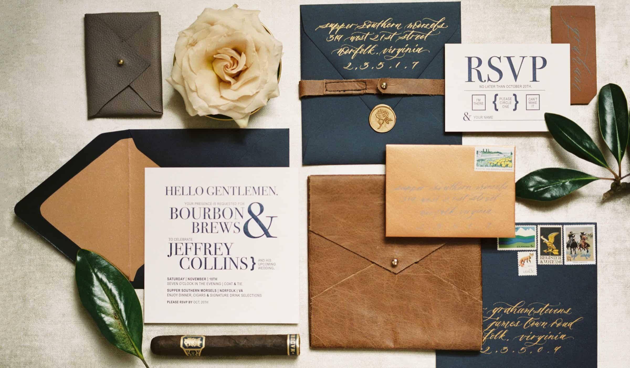 typography wedding invitation with navy blue envelope and leather details