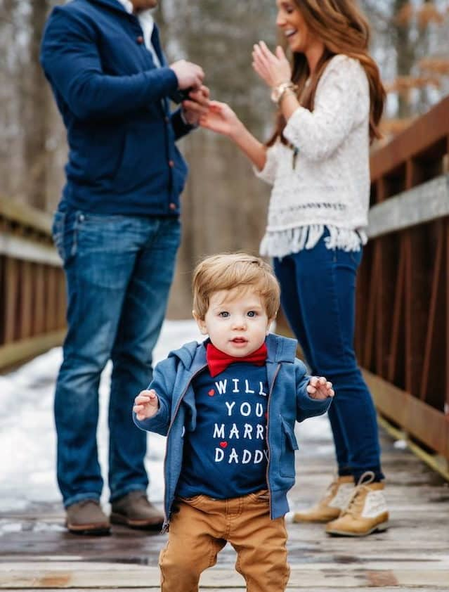 a child with a t-shirt with a wedding proposal