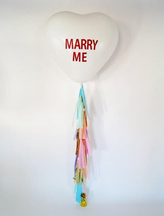 wedding proposal with heart shape balloon