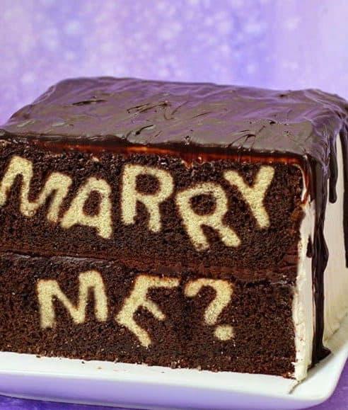 wedding proposal on the chocolate cake