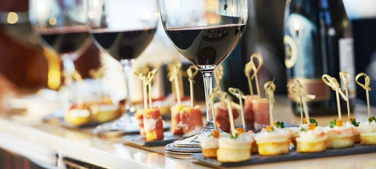 wedding catering with finger foods and glasses of red wine