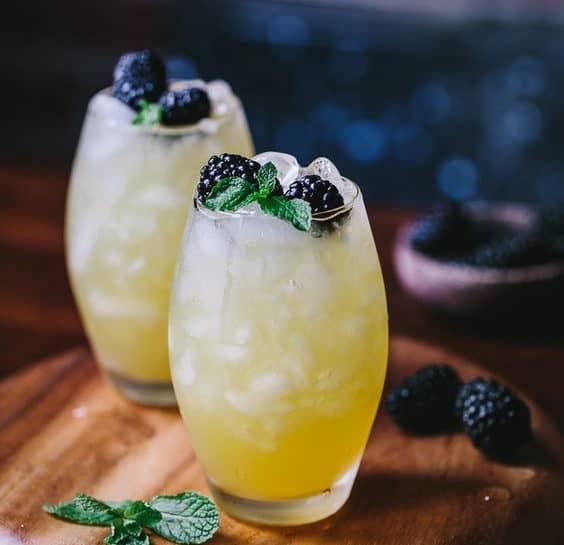 wedding summer cocktail with mango & blackberry vodka cooler