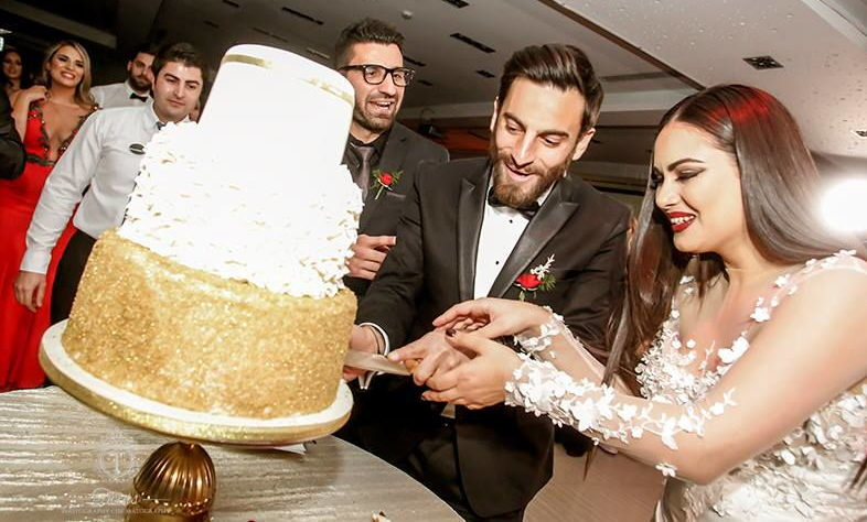 real wedding in Cyprus the couple cut the wedding cake