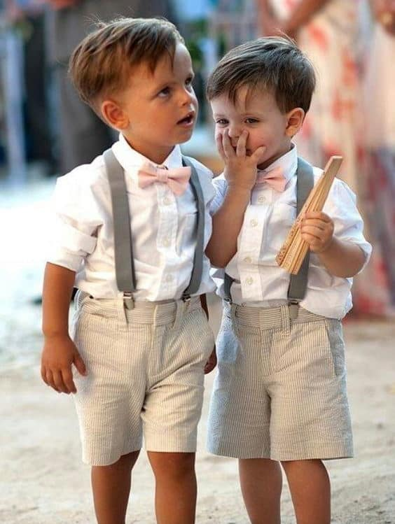 wedding page boys with suspenders and pink bow tie