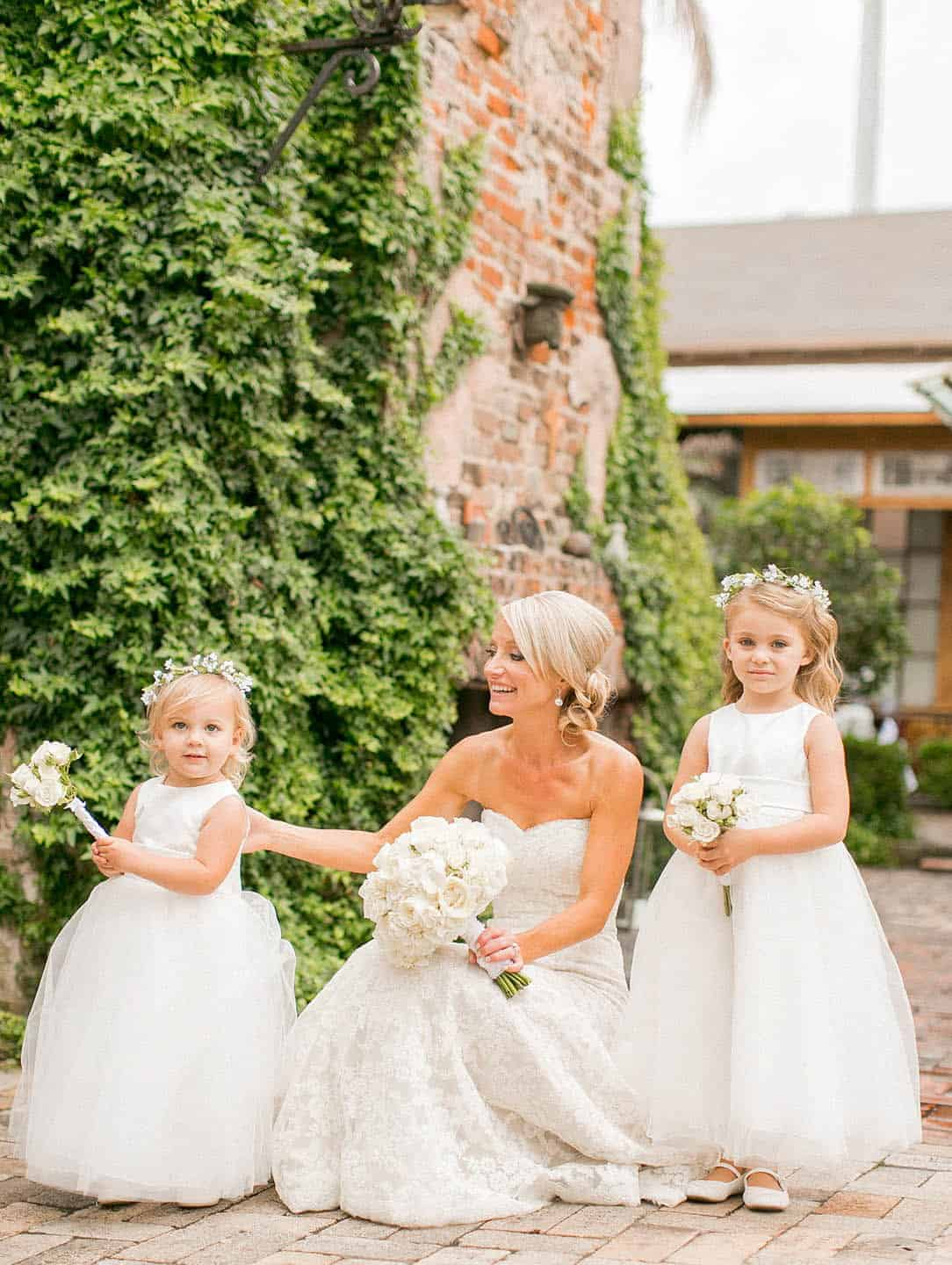 bride and flower girls wear the same dresses