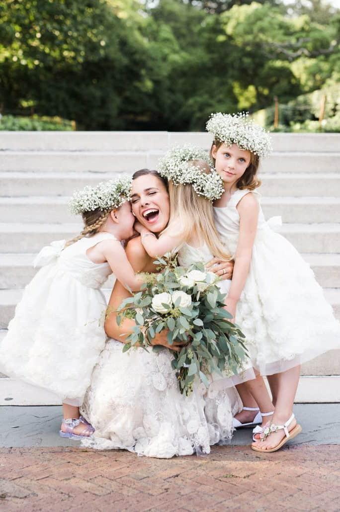 bride with flower girls, white wedding bouquet and white head wreath