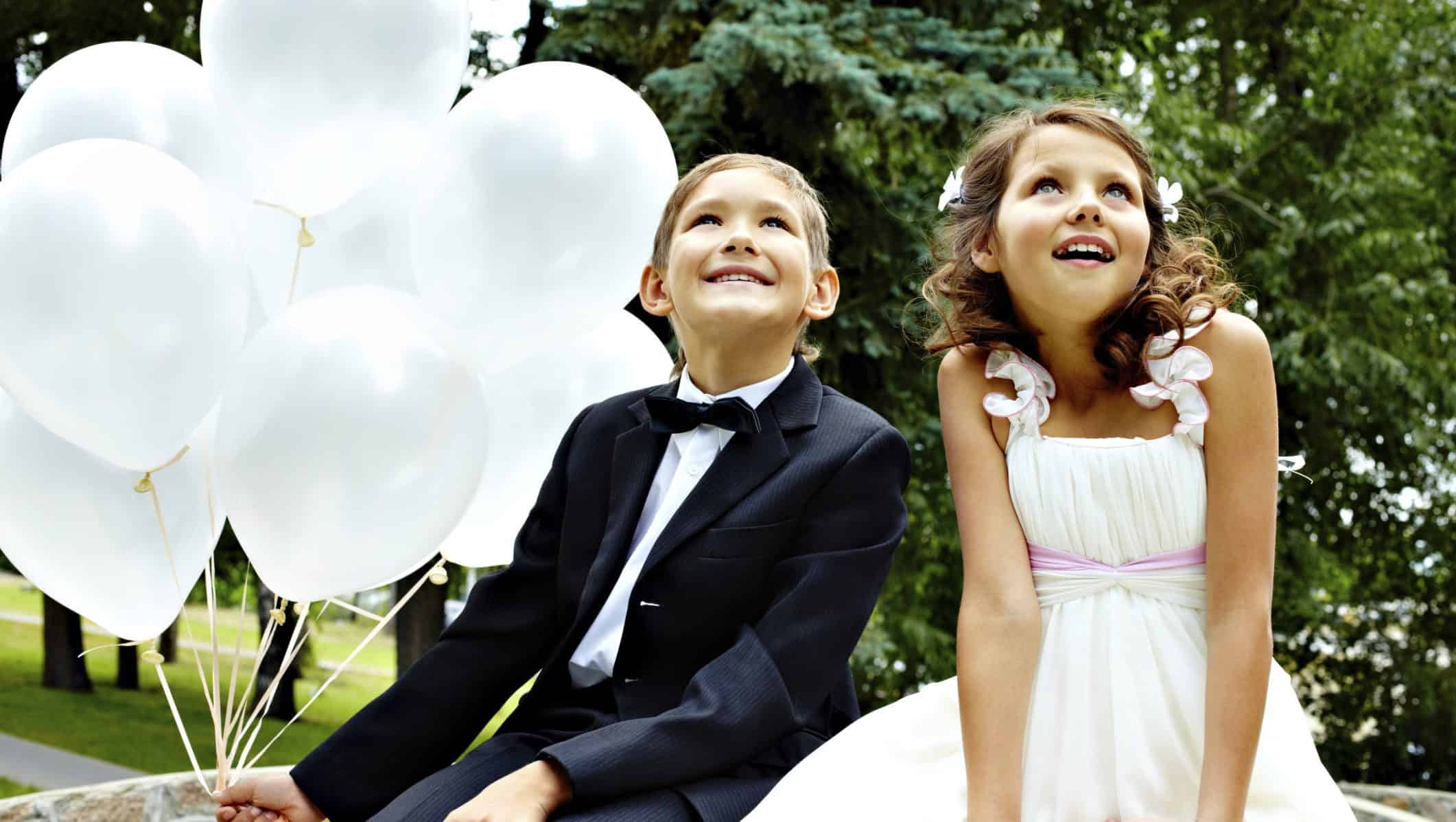 flower girl and page boy with balloons