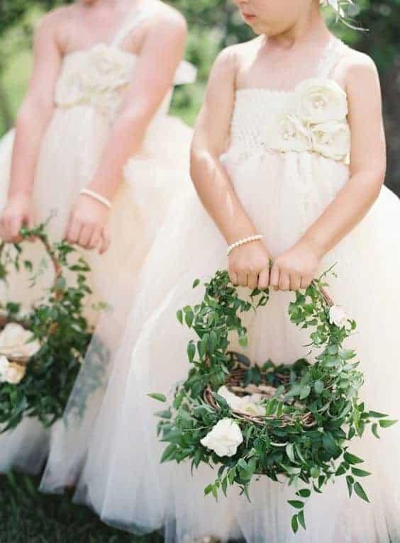 wedding flower girls holding floral baskets