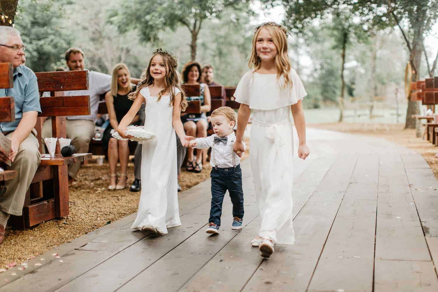wedding ceremony flowers girls and page boy