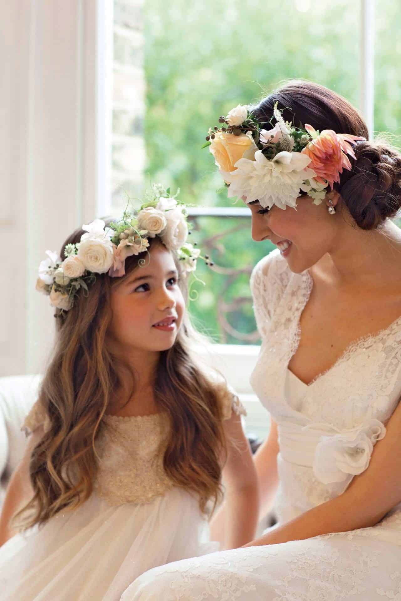 flower girl and bride with flower head wreath