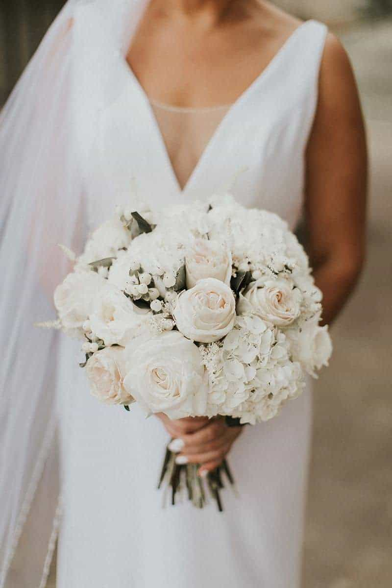 round wedding bouquet with white roses