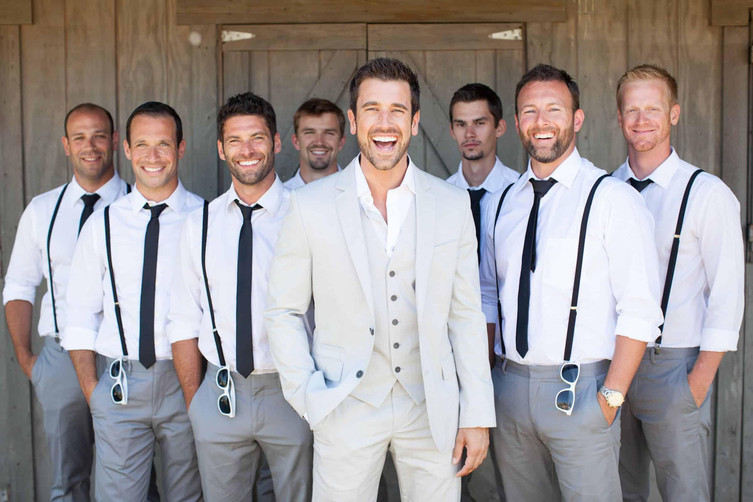 groom and the wedding groomsmen wearing the same suit