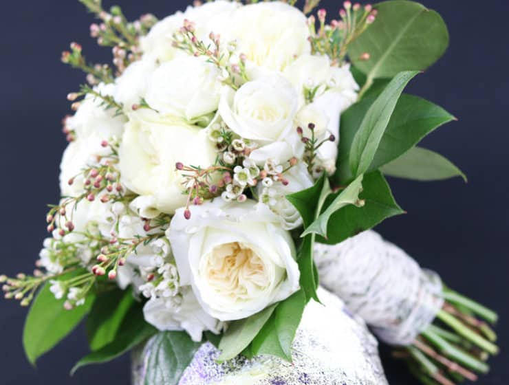 Bouquet of white flowers with greenery and tied together with white bindings, by Kerazi Flowers & Weddings in Cyprus.